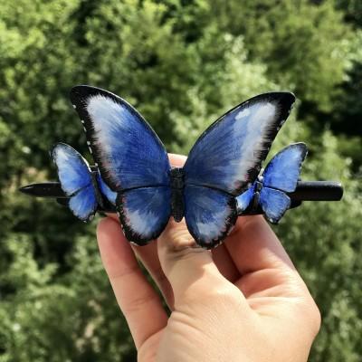 Wooden hair barrette with butterflies.
